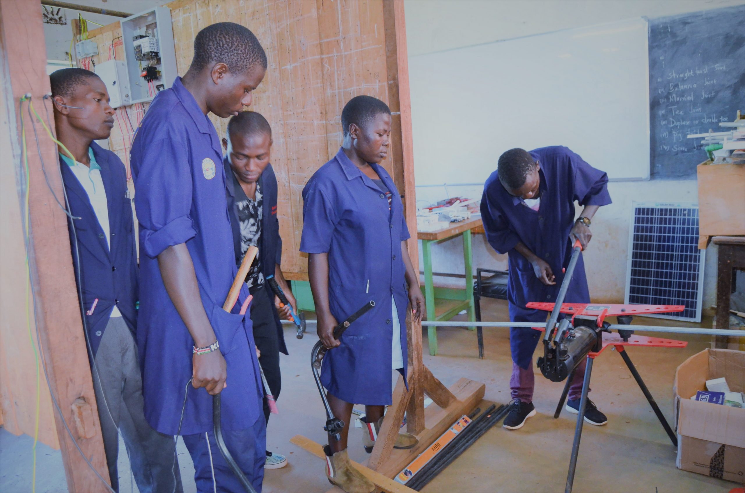 Electricl Engineering Trainees in a Practical Session