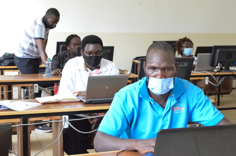 Kevin Musoli providing support during an E-learning class