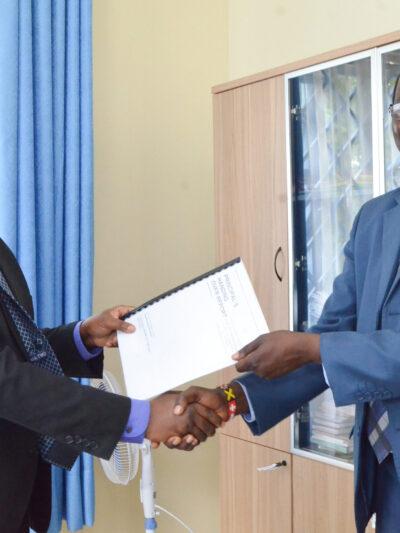 Mr. Okumu (left) and Mr. Randa